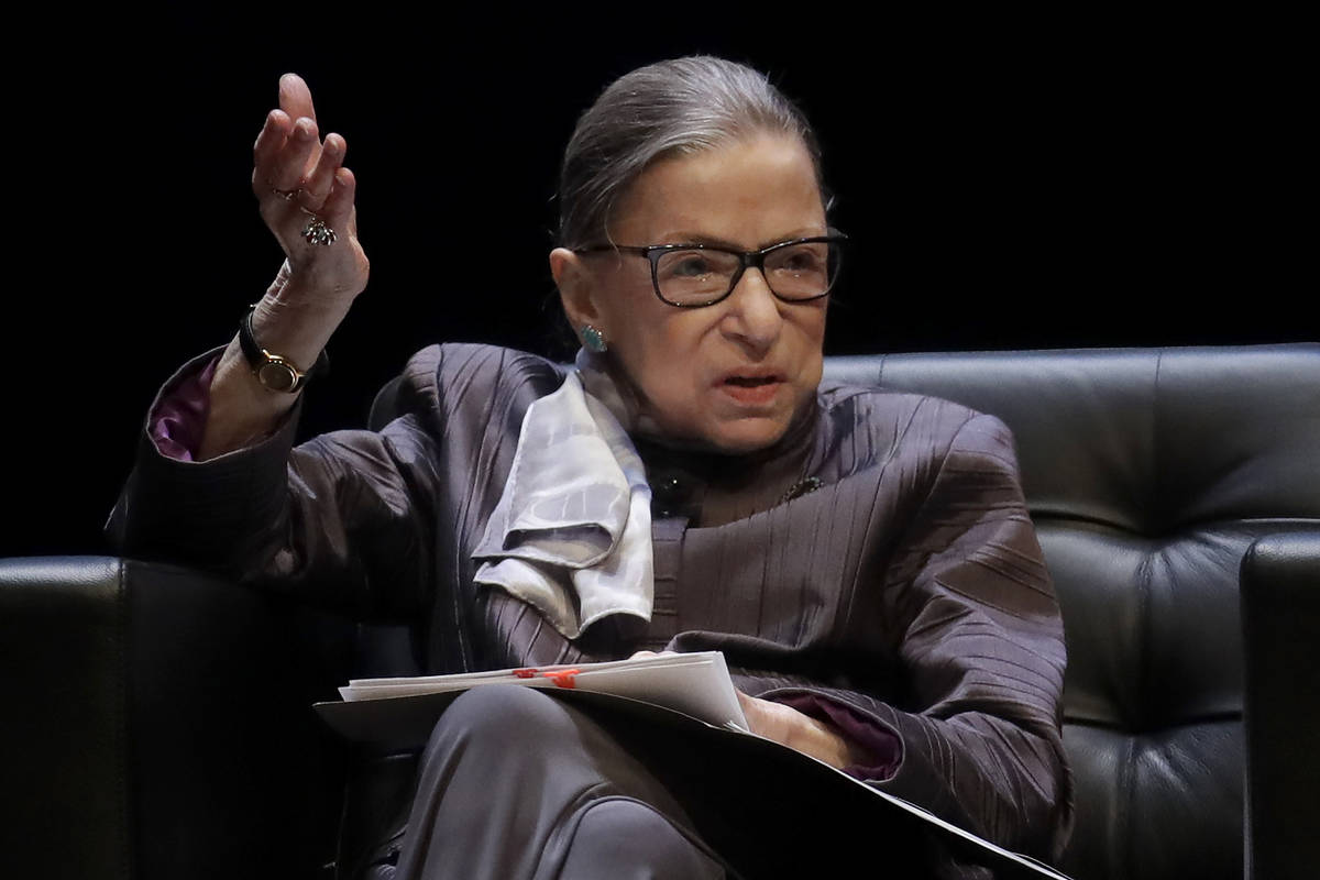 In this Oct. 21, 2019, file photo, U.S. Supreme Court Justice Ruth Bader Ginsburg gestures whil ...