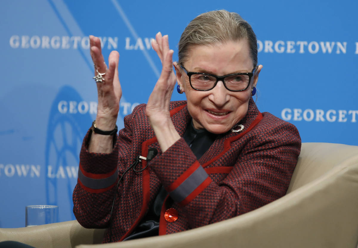 In this April 6, 2018, file photo, Supreme Court Justice Ruth Bader Ginsburg applauds after a p ...
