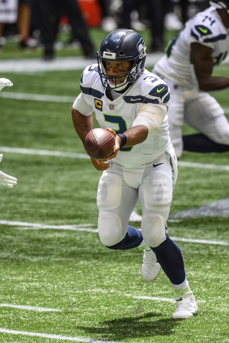 Seattle Seahawks quarterback Russell Wilson (3) works against the Atlanta Falcons during the fi ...