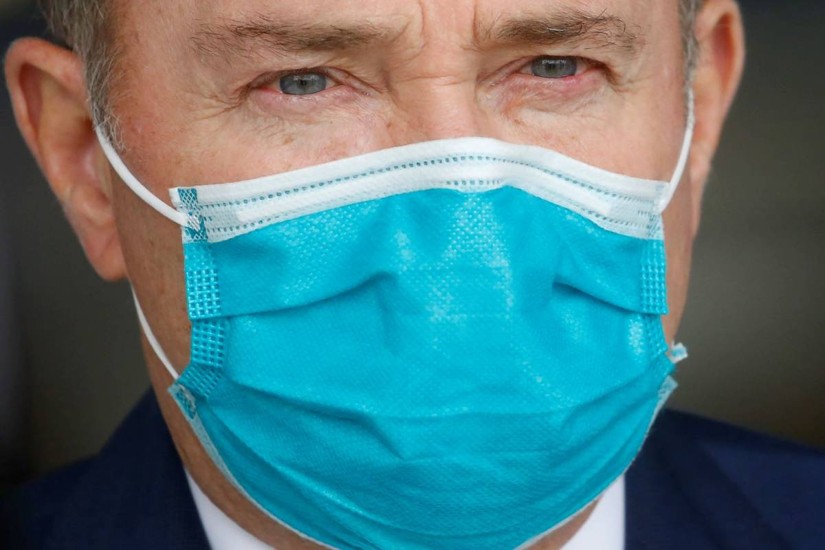 Utah Gov. Gary Herbert wears a mask during a news conference on April 15, 2020, in Salt Lake Ci ...