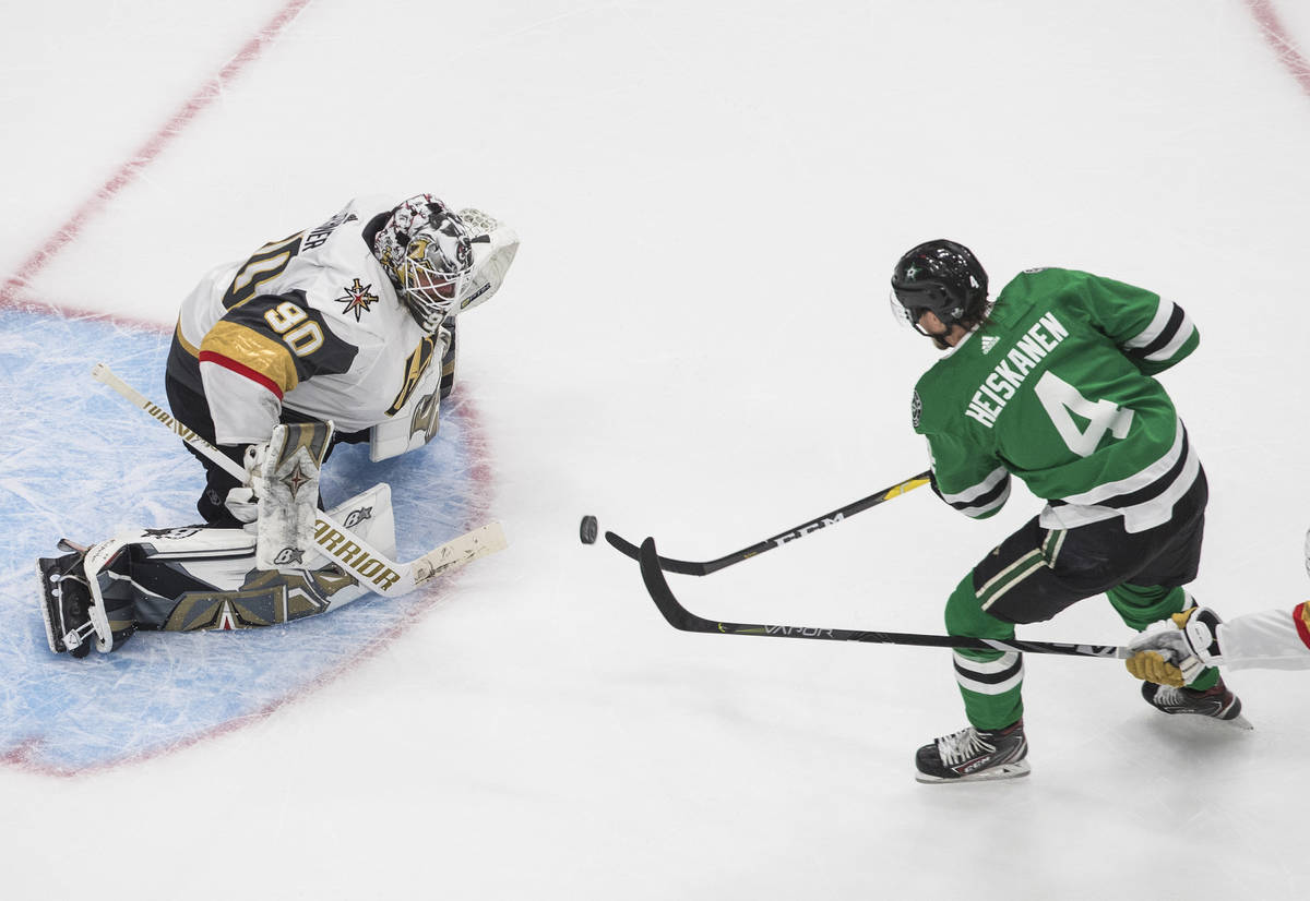 Dallas Stars' Miro Heiskanen (4) is stopped by Vegas Golden Knights goalie Robin Lehner (90) du ...