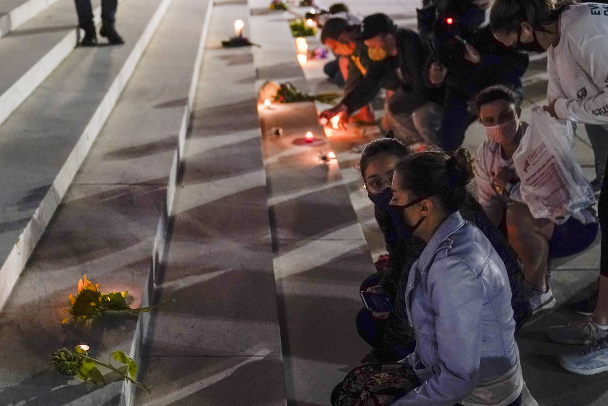People lay flowers and light candies outside the Supreme Court Friday, Sept. 18, 2020, in Washi ...