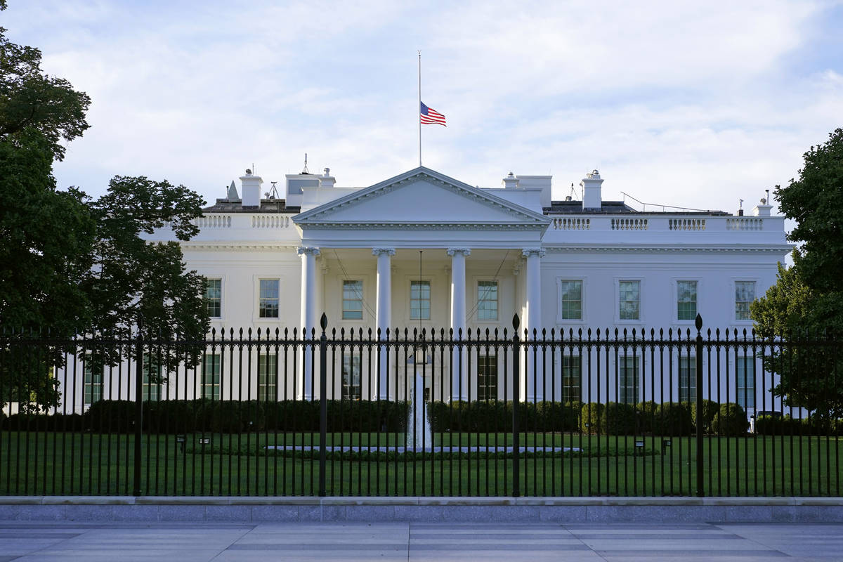 An American flag flies at half-staff over the White House in Washington, Saturday, Sept. 19, 20 ...