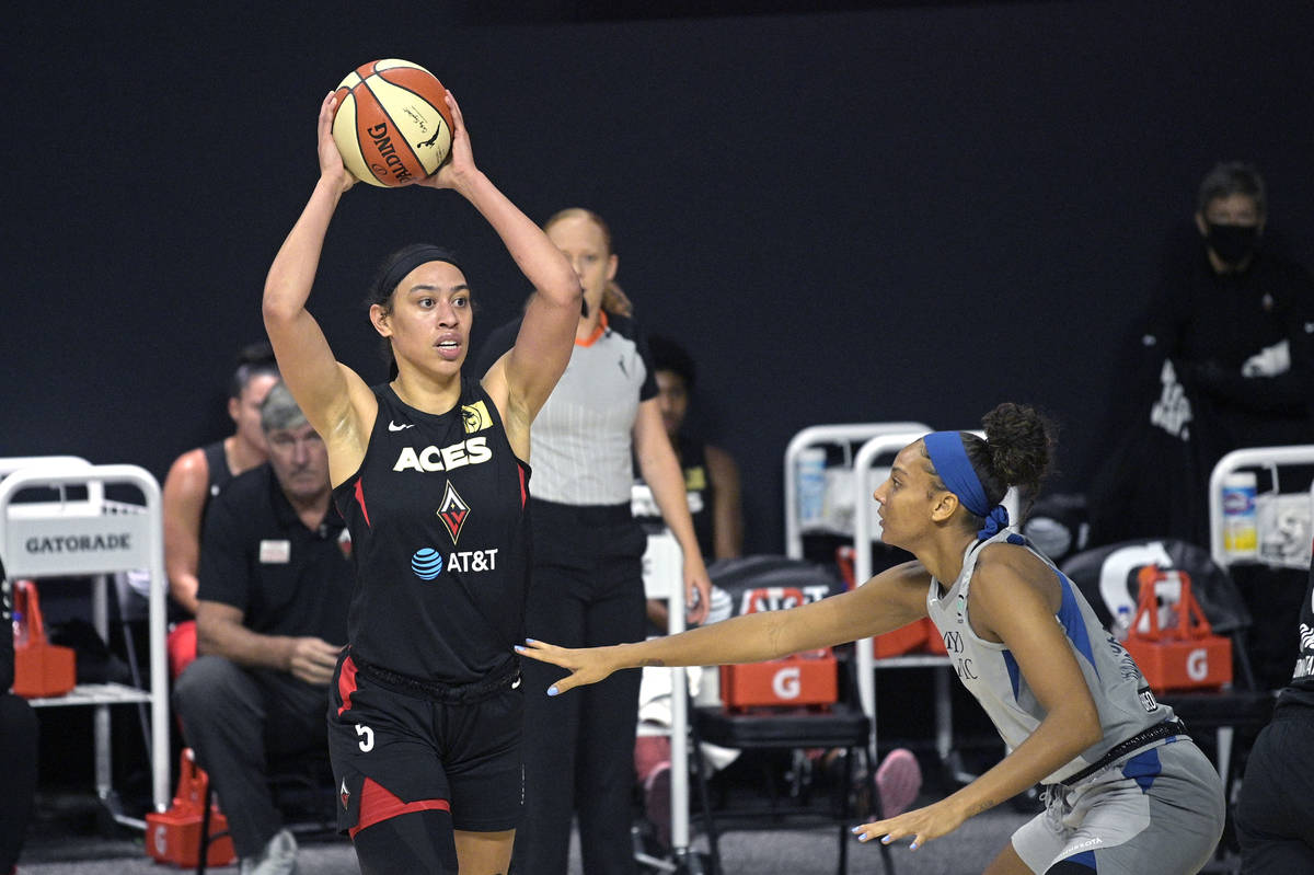 Las Vegas Aces forward Dearica Hamby (5) looks to pass the ball in front of Minnesota Lynx forw ...
