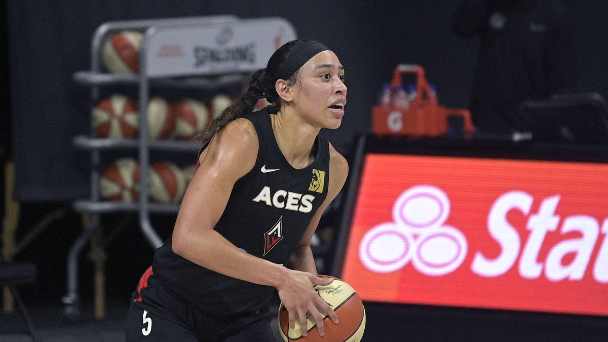 Las Vegas Aces forward Dearica Hamby (5) looks to pass the ball up the court during the first h ...