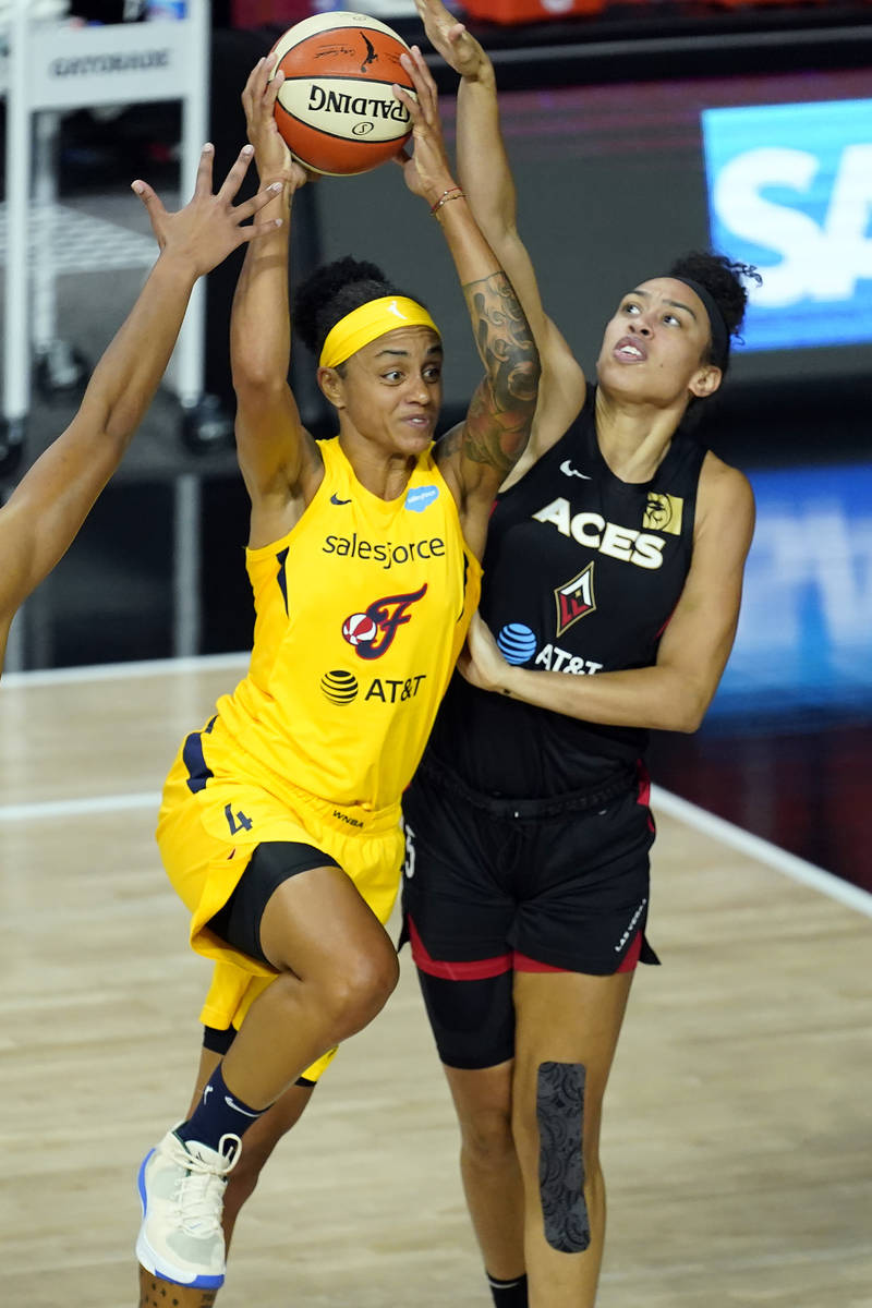 Indiana Fever forward Candice Dupree (4) goes up against Las Vegas Aces forward Dearica Hamby ( ...