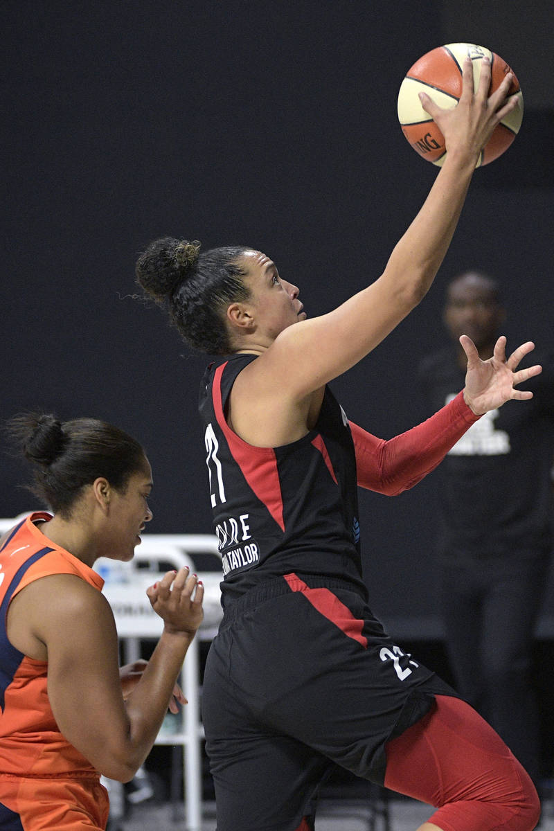 Las Vegas Aces guard Kayla McBride (21) goes up to shoot in front of Connecticut Sun center Bri ...