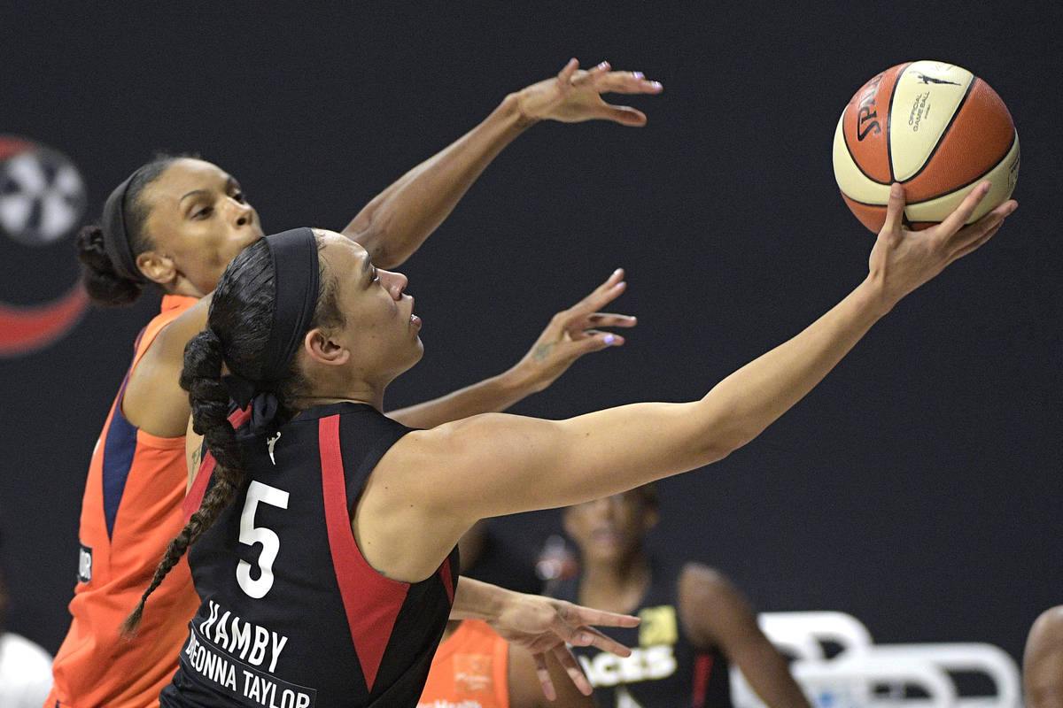 Las Vegas Aces forward Dearica Hamby (5) goes up to shoot in front of Connecticut Sun forward D ...