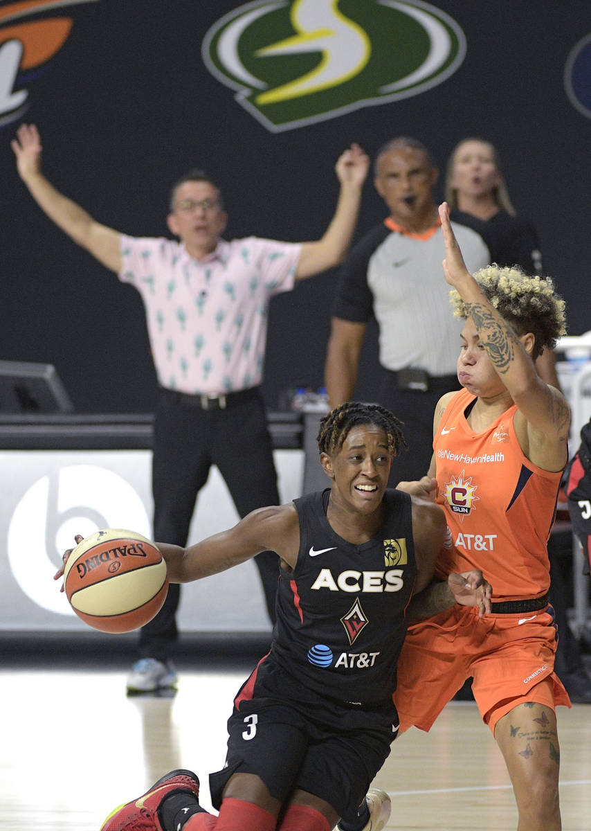 Las Vegas Aces guard Danielle Robinson (3) drives to the lane while defended by Connecticut Sun ...