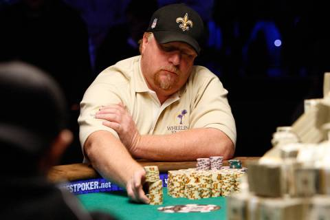 Darvin Moon moves in a stack of chips during the 2009 World Series of Poker at Rio hotel-casino ...