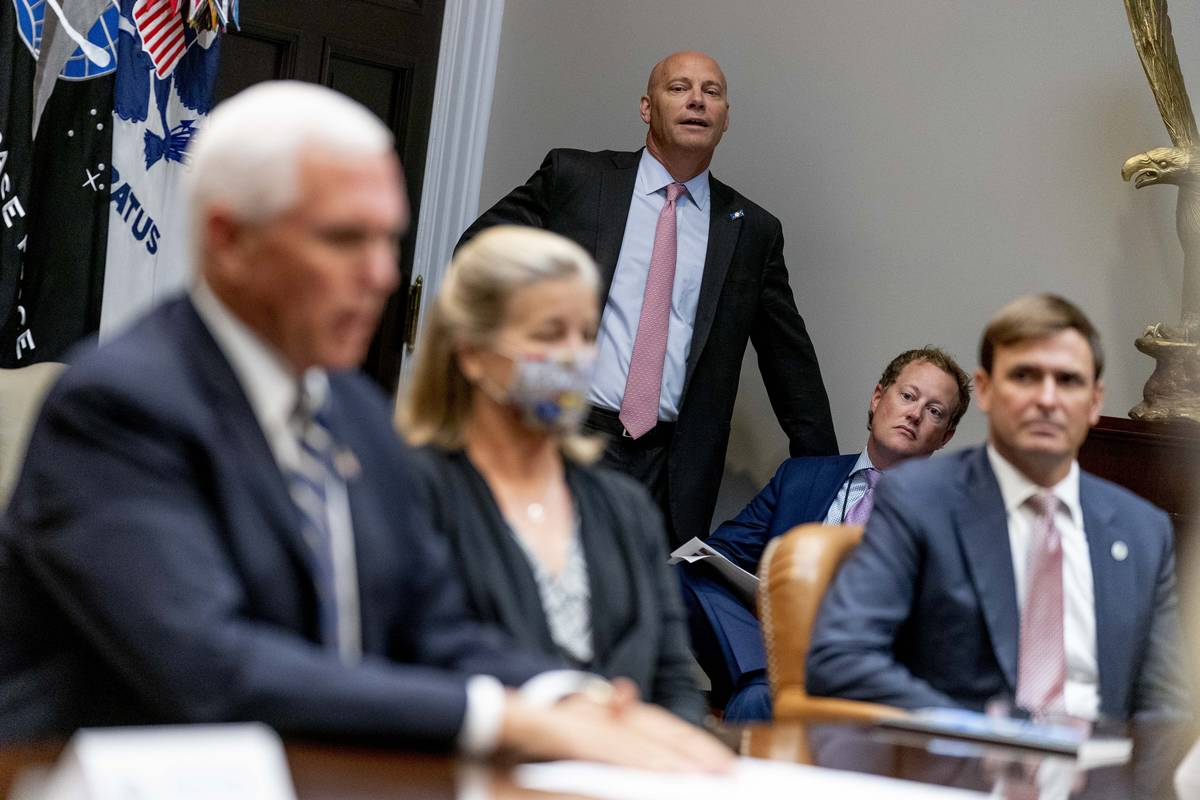 Vice President Mike Pence's Chief of Staff Marc Short, center, listens as Vice President Mike P ...
