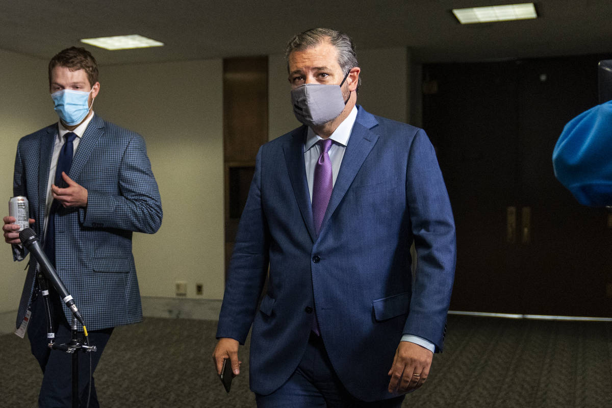Sen. Ted Cruz, R-Texas, right, leaves a Senate Republican policy meeting on Capitol Hill, Thurs ...