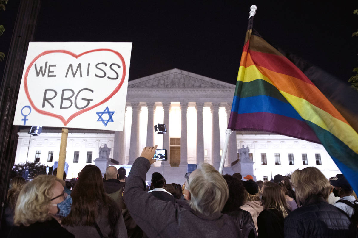 People gather at the Supreme Court to honor the late Justice Ruth Bader Ginsburg, Saturday, Sep ...