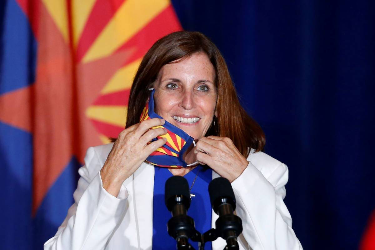 Sen. Martha McSally, R-Ariz., smiles as she removes her face covering to speak prior to Vice Pr ...