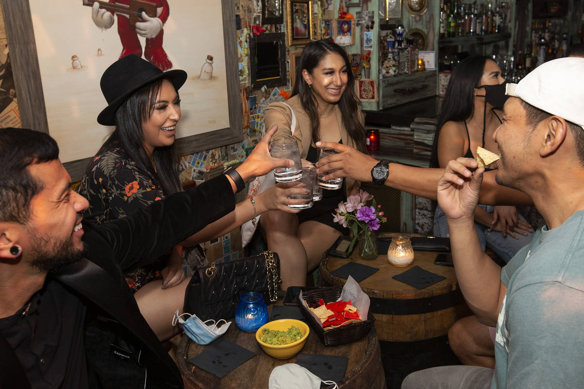 Gee Santos, left, Flor Castaneda, second from left, and Andrea Cisneros, center, cheers with th ...