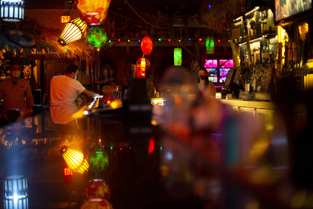 The Golden Tiki's video poker spots at the bar are empty on the first night that bars were allo ...