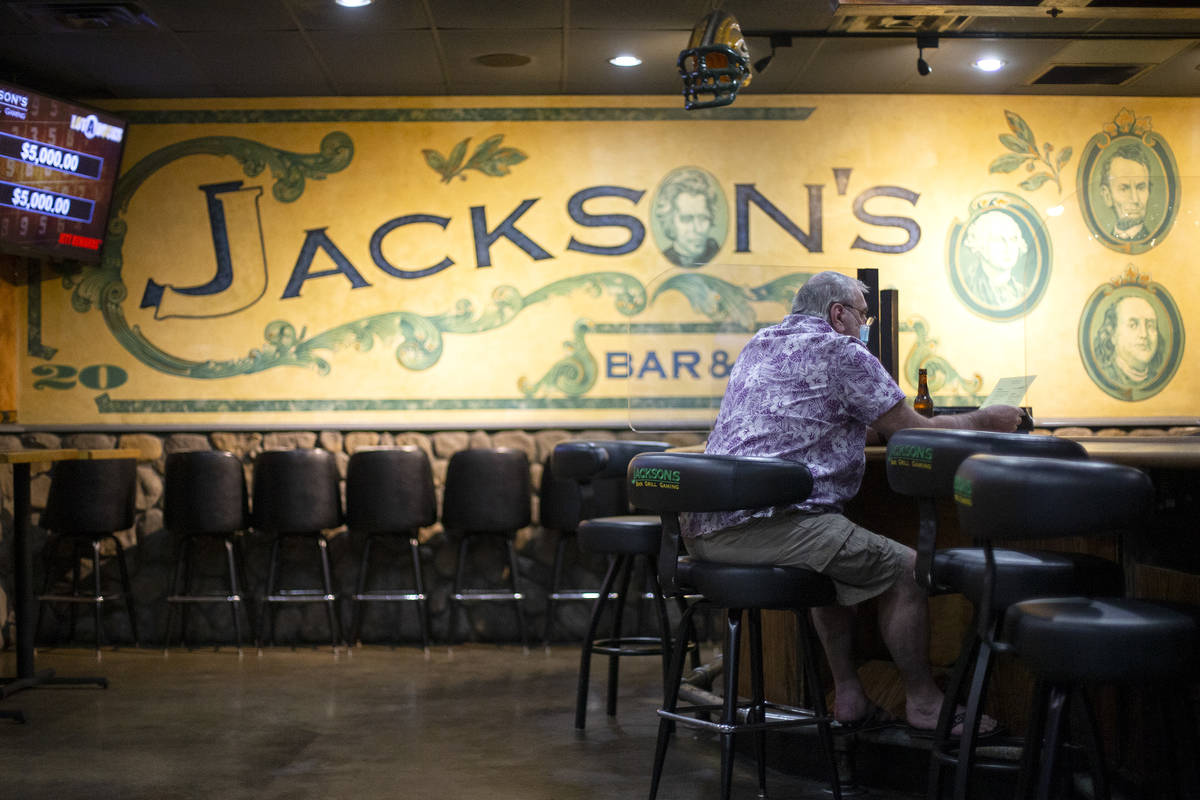 Jim Yerardi of Las Vegas sits down for a beer and a meal at Jackson's Bar and Grill in the earl ...