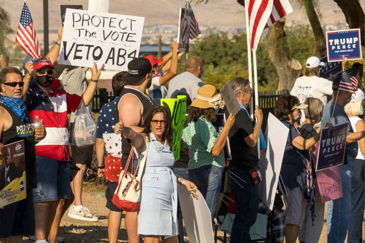 Protestors rally outside the Grant Sawyer building to voice opposition against AB4, a controver ...
