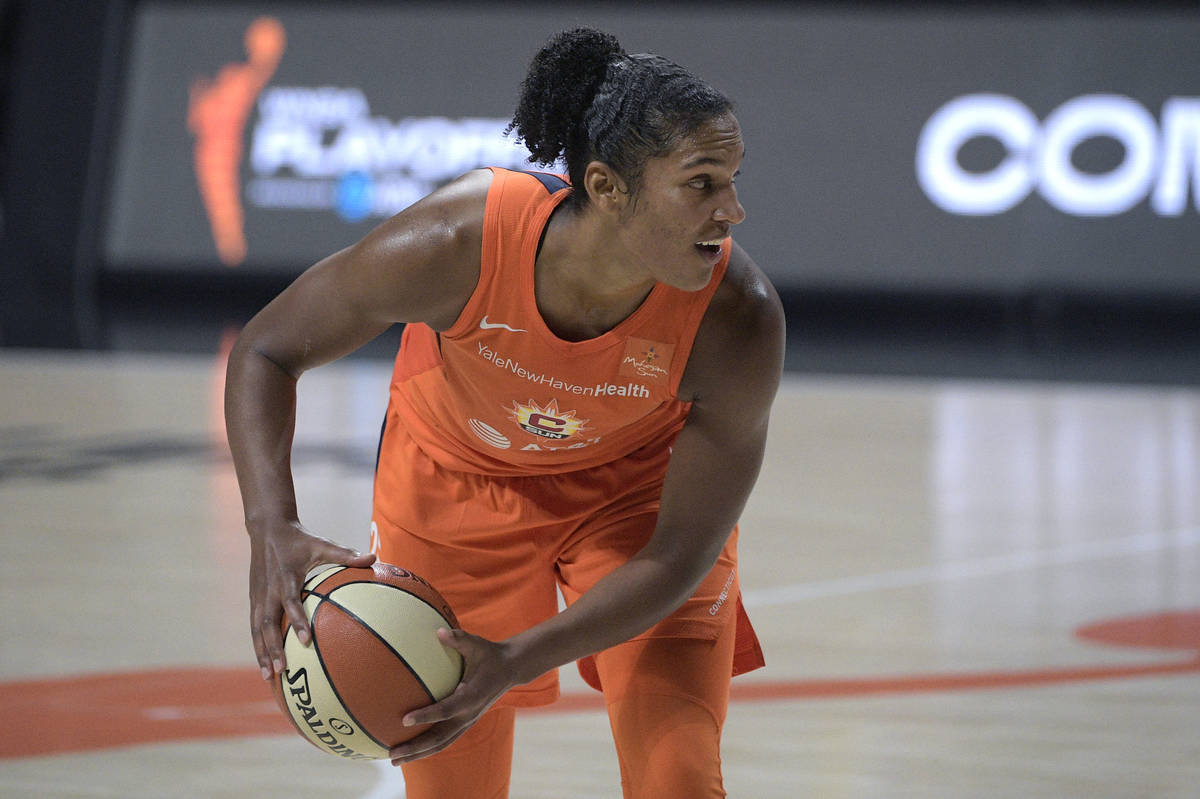 Connecticut Sun forward Alyssa Thomas (25) sets up a play during the second half of Game 1 of a ...