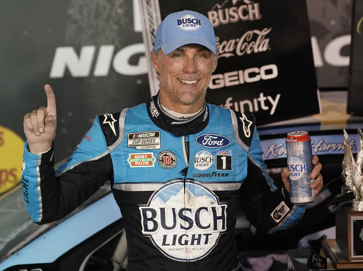 Kevin Harvick celebrates in Victory Lane after winning the NASCAR Cup Series auto race Saturday ...