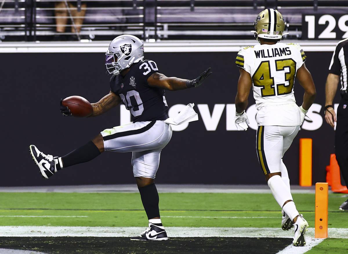 Las Vegas Raiders running back Jalen Richard (30) scores a touchdown past New Orleans Saints fr ...