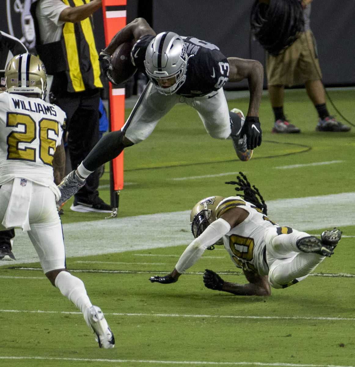 Las Vegas Raiders tight end Darren Waller (83) holds onto a catch after being taken off his fee ...