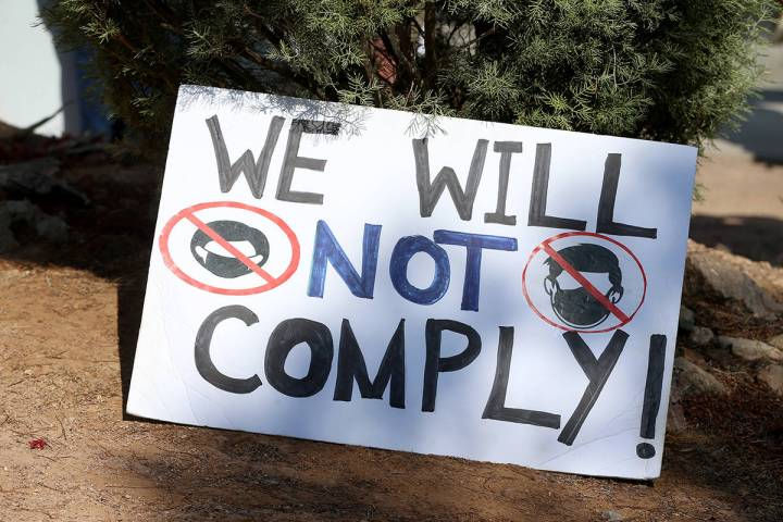 A sign on the ground during a No Mask Nevada PAC rally at Sunset Park in Las Vegas, Saturday, A ...