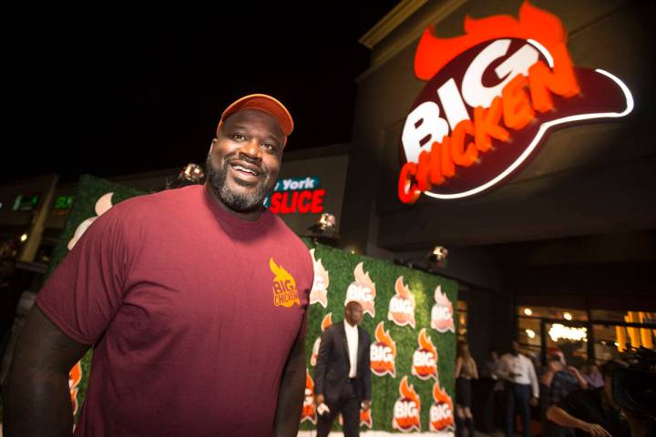Retired NBA player Shaquille O'Neal smiles during the grand opening celebration of Big Chicken, ...