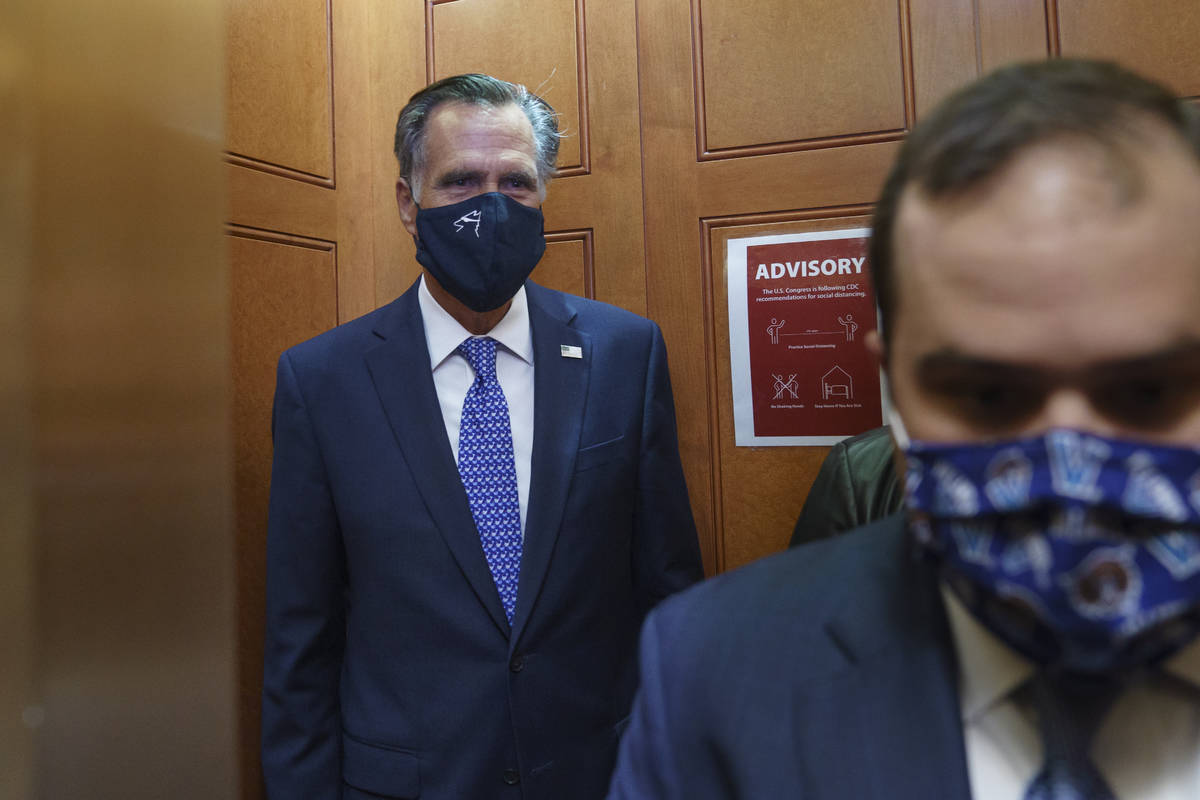 Sen. Mitt Romney, R-Utah, leaves the Senate Chamber after a procedural vote, at the Capitol in ...