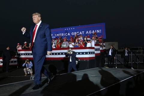 President Donald Trump holds a campaign rally at the Minden-Tahoe Airport in Nevada on Saturday ...