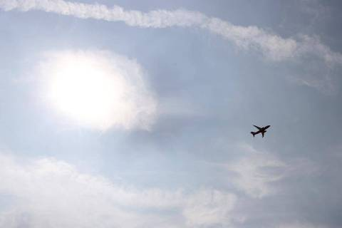 A plane departs McCarran International Airport in Las Vegas, Thursday, Sept. 17, 2020. Smoke an ...