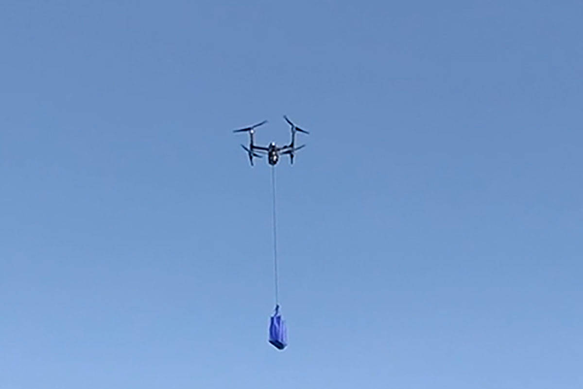 Walmart is taking to the skies to deliver at-home COVID-19 testing kits in North Las Vegas. (Ph ...