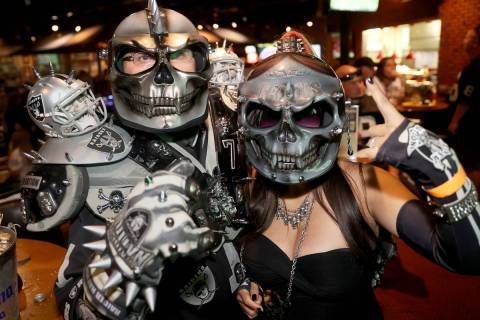 "Las Vegas Raiders fans Julio ""Crime Scene"" Caballero and his fiancee Dina ""Dynam ..."
