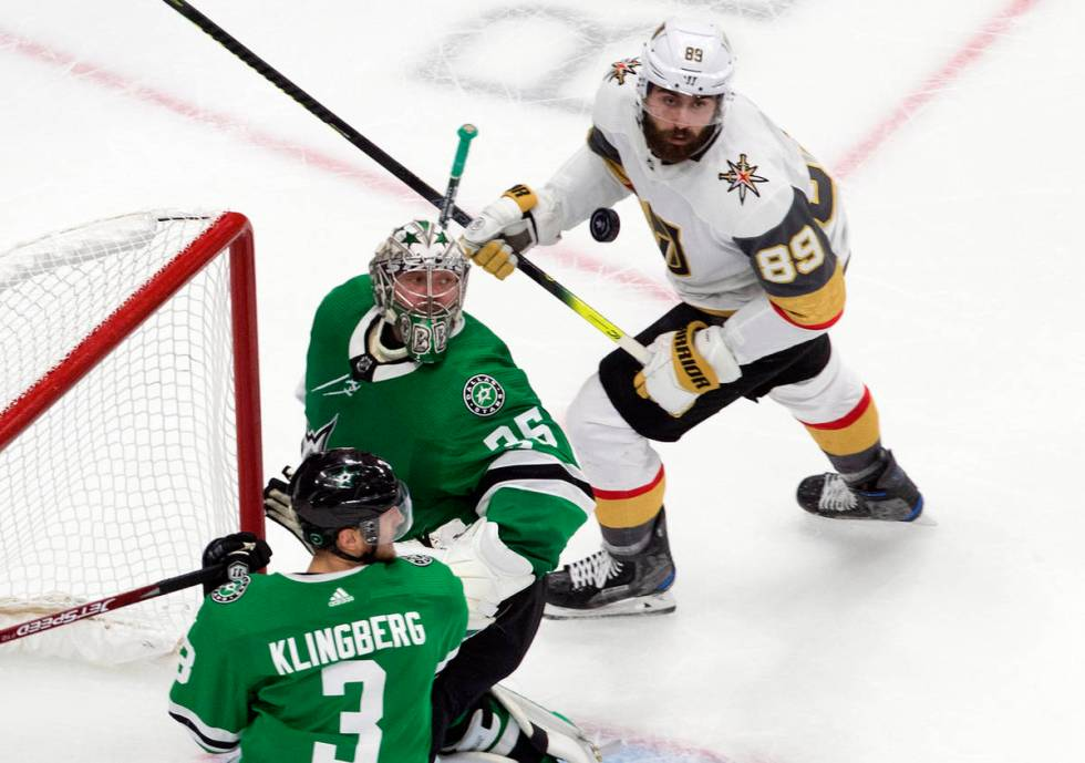 Dallas Stars goalie Anton Khudobin (35), Stars' John Klingberg (3) and Vegas Golden Knights' Al ...
