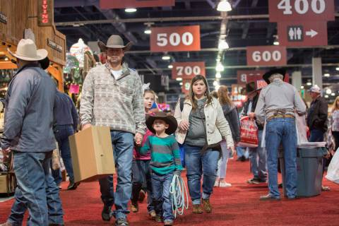 Shoppers walk the South Halls during Cowboy Christmas at the Las Vegas Convention Center on Thu ...