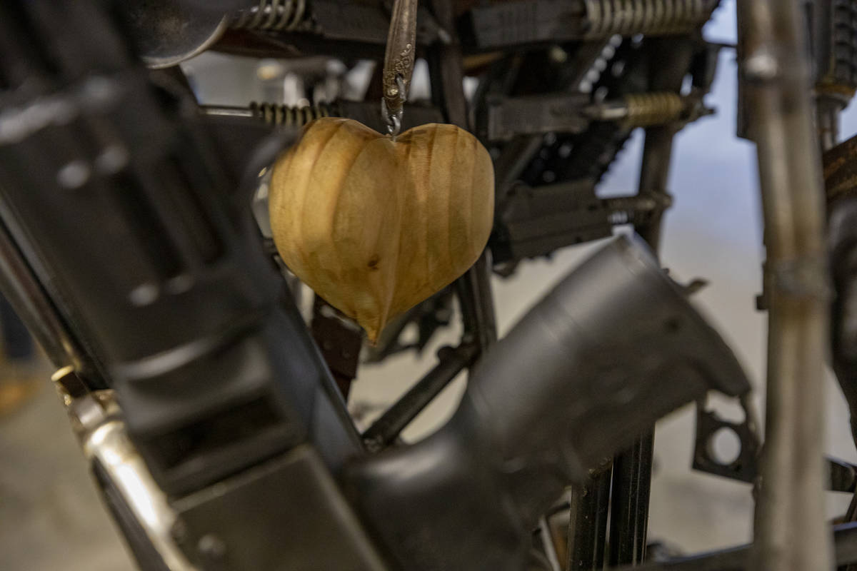 A wooden heart is seen in the chest of David Fay's sculpture commissioned by Indecline titled ' ...