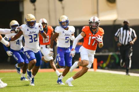 Oklahoma State wide receiver Dillon Stoner (17) runs the ball against Tulsa during an NCAA coll ...