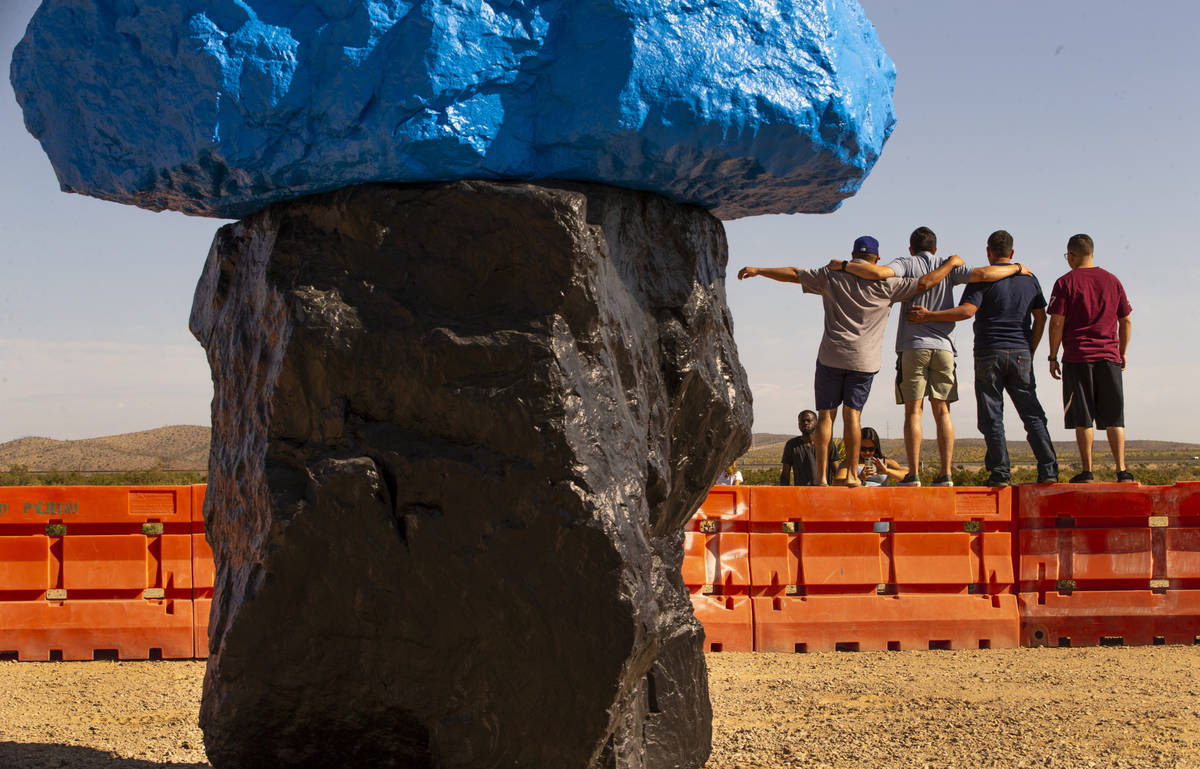 Visitors pose for a photo atop barricades on June 14. More than 321,000 people visited the site ...