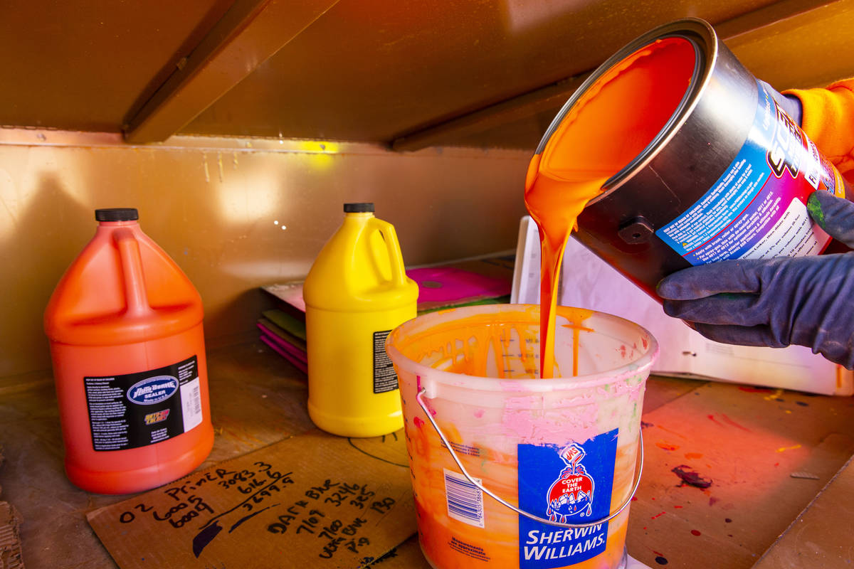John Henderson mixes a batch of orange finish on June 17. The bright colors are typical of a Ro ...