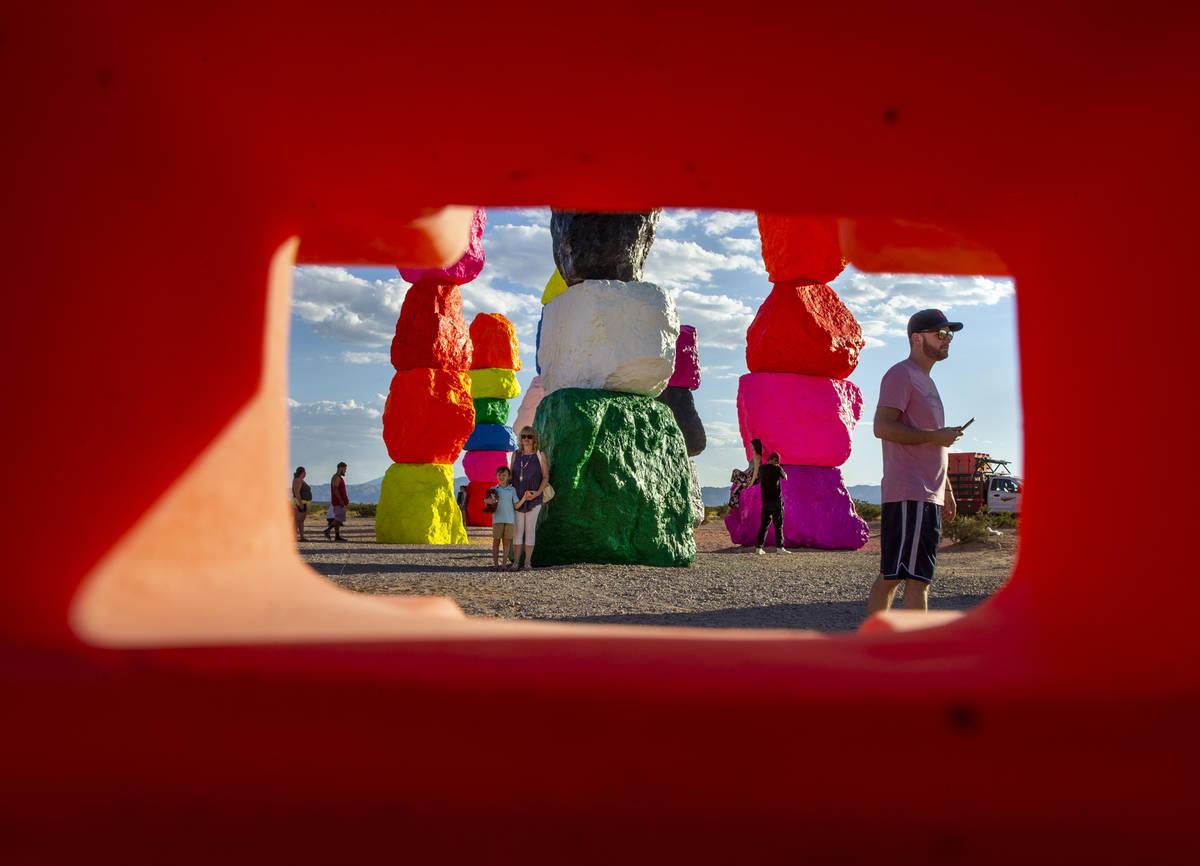 Visitors explore the newly restored Seven Magic Mountains art installation on June 18. (L.E. Ba ...