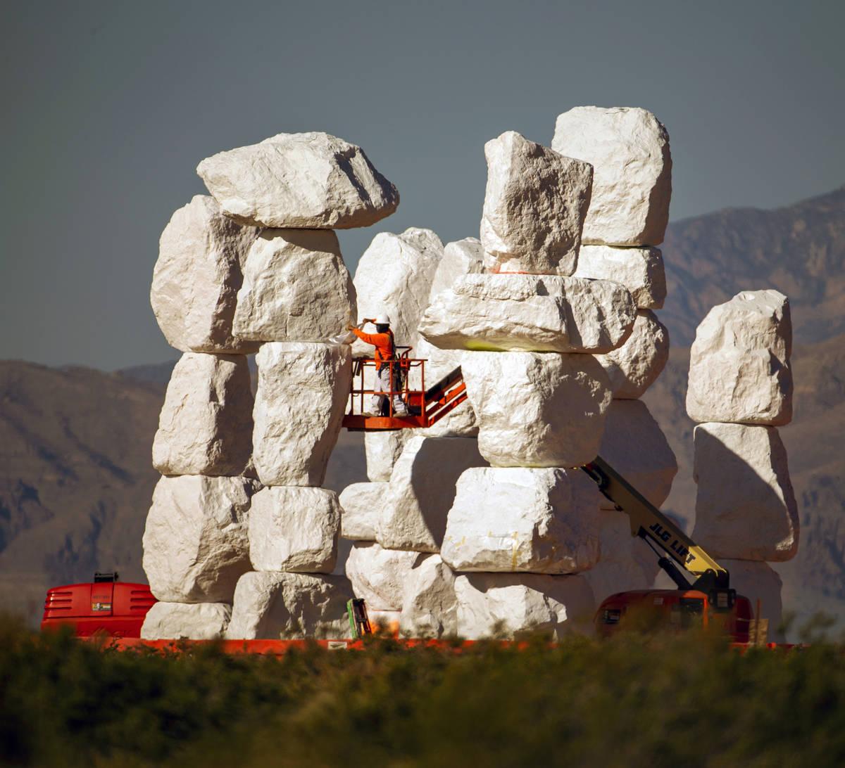 Ivan Ibarra applies primer on June 4. The towers stand 30-35 feet tall. (L.E. Baskow/Las Vegas ...