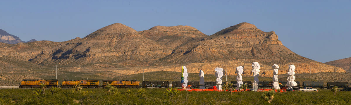 A train rolls by the Seven Magic Mountains on June 4. The installation is the largest land art ...