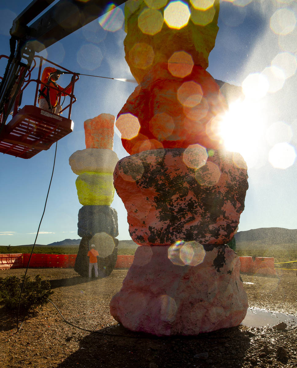 Ivan Ibarra pressure washes a tower after a week of high winds and other safety concerns delaye ...