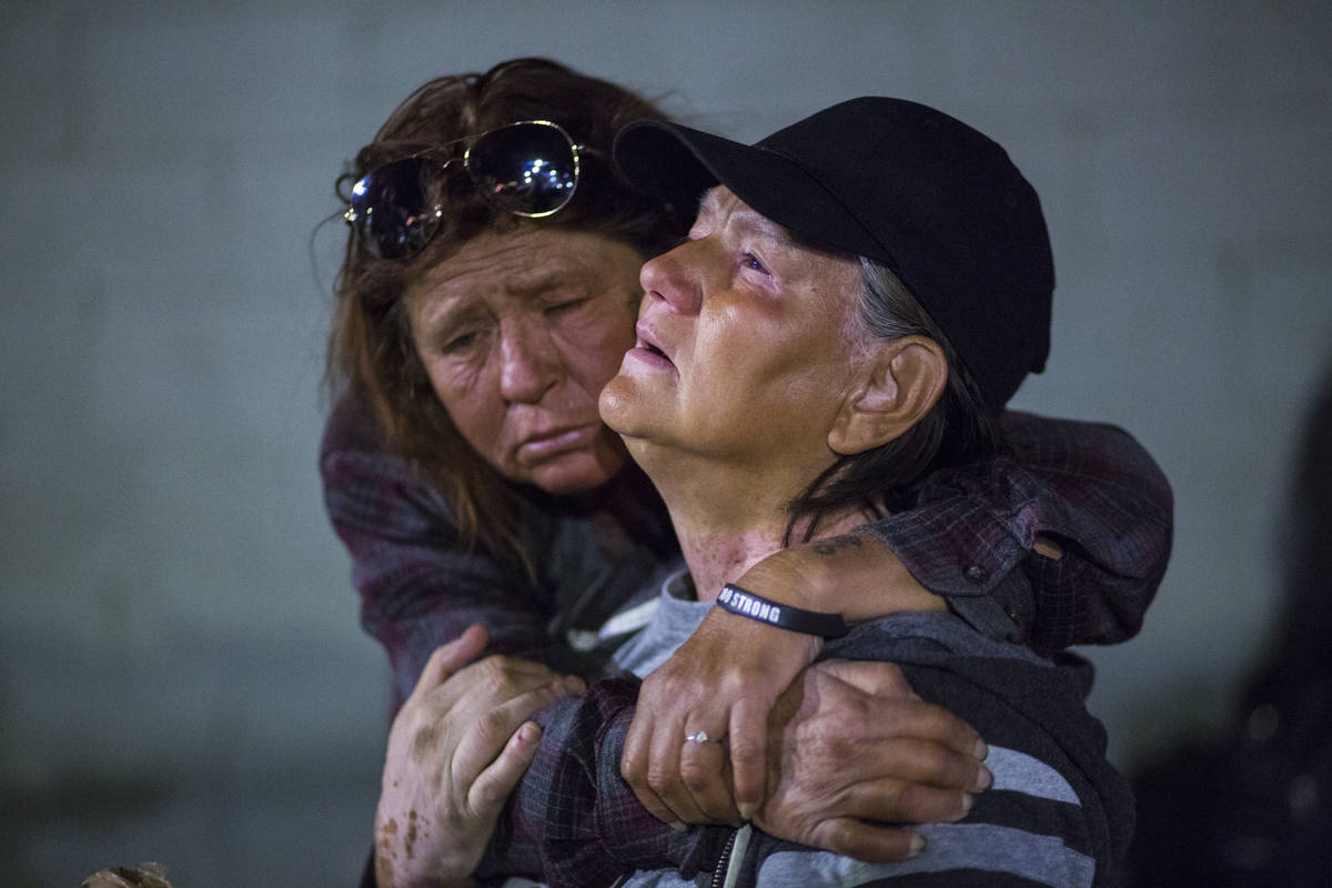In this Tuesday, Oct. 15, 2019 photo, Alice Pate, left, comforts Kathleen Sutton as she talks a ...