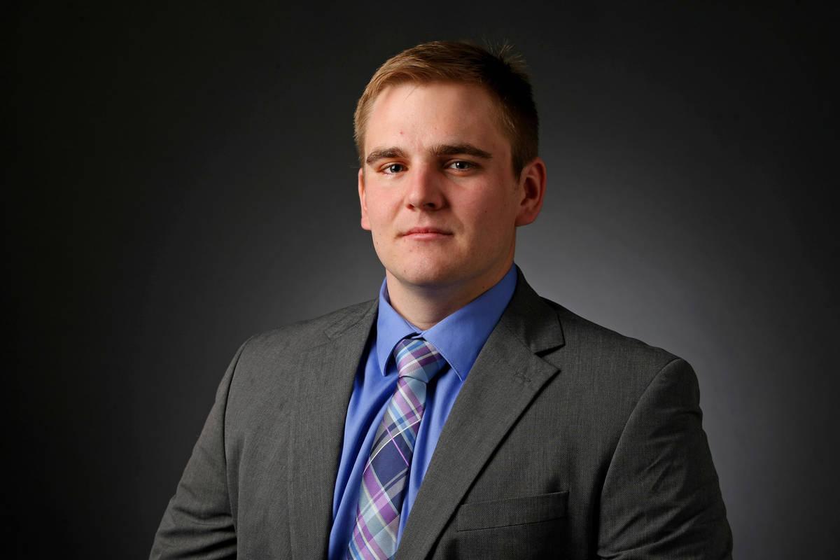 Michael Scott Davidson, reporter, poses for a portrait at the Las Vegas Review-Journal photos s ...