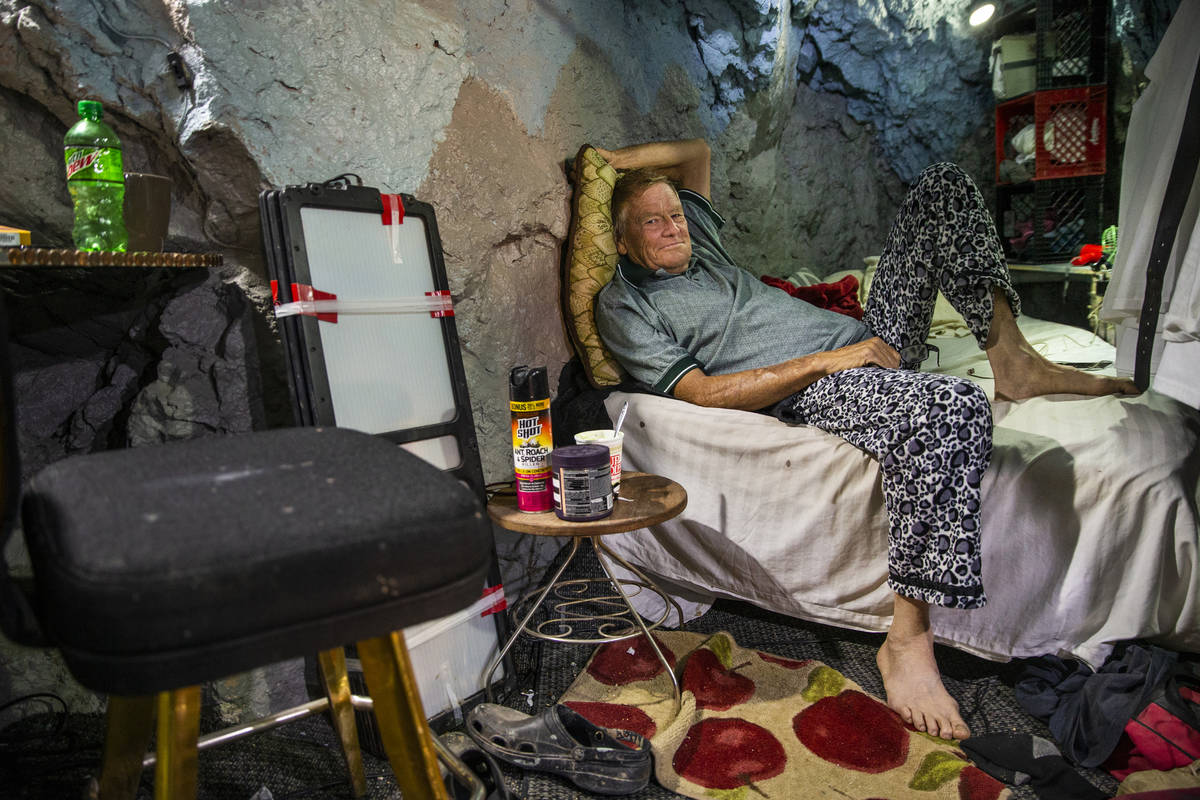 Richard Roman relaxes on his bed while living in a former mine in the hillside above the River ...