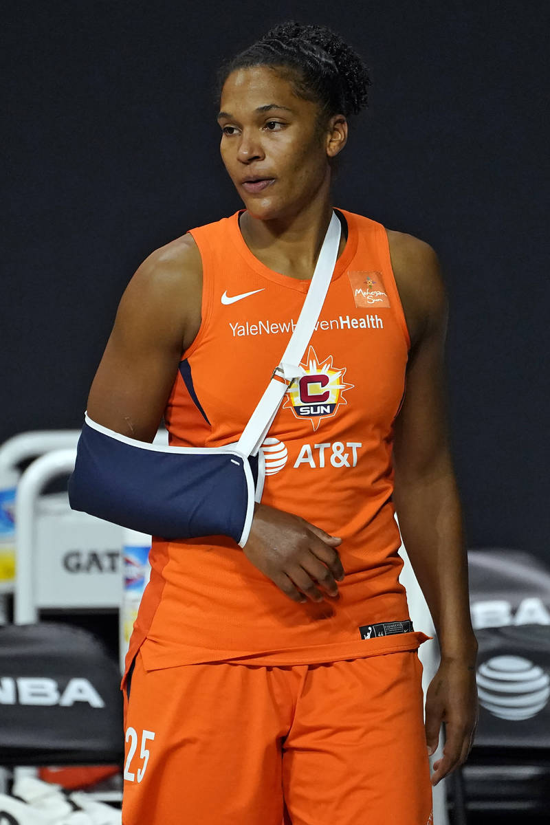 Connecticut Sun forward Alyssa Thomas (25) watches from the bench after getting injured during ...