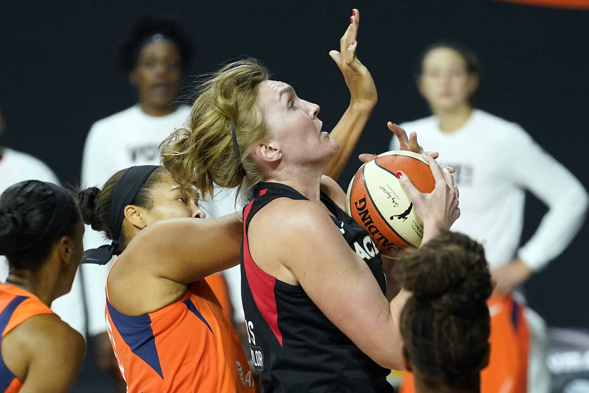 Las Vegas Aces center Carolyn Swords (4) loses control of the ball after getting hit by Connect ...