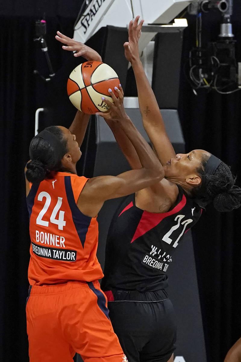 Connecticut Sun forward DeWanna Bonner (24) shoots against Las Vegas Aces center A'ja Wilson (2 ...