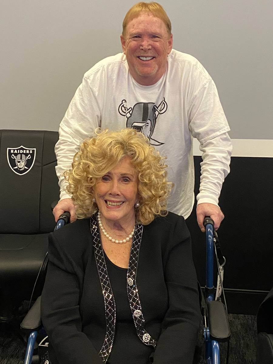 Mark Davis is shown with his mother, Carol, at Davis' Las Vegas Raiders opening watch party at ...